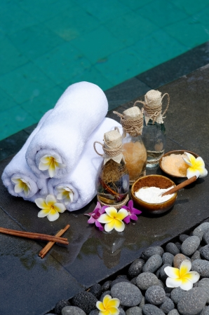 At the Spa, concept in a luxury Villa on Bali Island with, Massage oil, bath-salt, Volcanic stones, body scrub, Towels,Cinnamon sticks, Orchids and flowers   photo