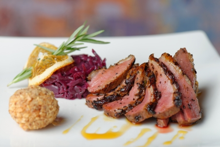 Duck breast fillet with red cabbage and potato ball