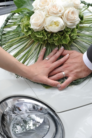 Wedding, Bride and Groom holding hands on the Vintage car  photo