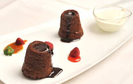 Chocolate souffle cakes on a dish  photo