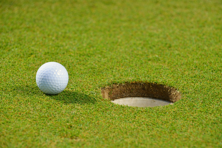 caddie: Golf ball on lip of cup
