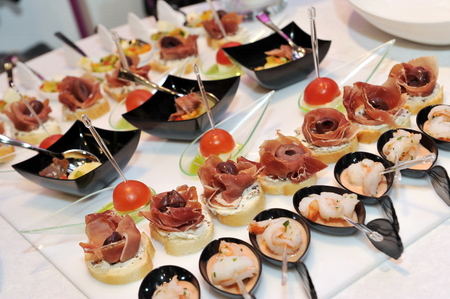 pumpernickel: Catering, a lot of cold snacks on buffet table Stock Photo