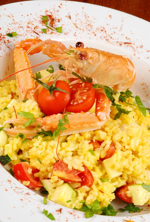 Risotto with Scampi, cherry tomatoes and seafood  Italian food   photo