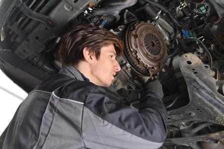 car repair shop: Auto Mechanic is working on engine in car repair shop  Stock Photo