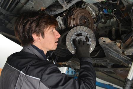 Vehicle Clutch, Car mechanic is changing Clutch  photo