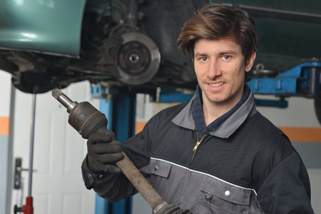 Auto Mechanic is working in car repair shop   photo