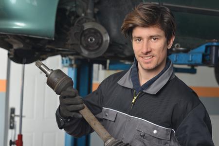 car repair shop: Auto Mechanic is working in car repair shop   Stock Photo