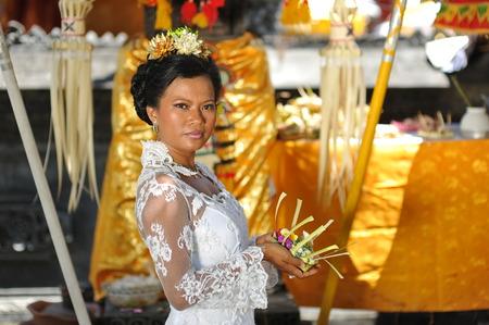 Beautiful asian bride prays in the temple  Bali  Indonesia  photo