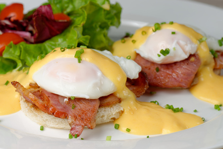 golden eggs: Eggs Benedict- toasted English muffins, ham, poached eggs, and delicious buttery hollandaise sauce