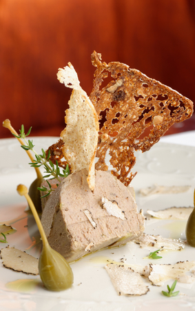 Foie gras pate with white truffles, capers and parmesan cheese photo