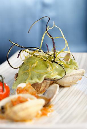 Delicious Fresh Steamer Clams, spinach ravioli, Garlic, tomatoes and Basil  photo