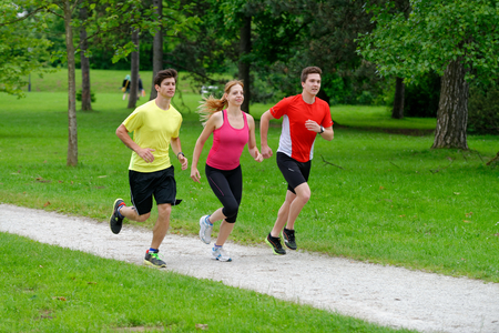 Three athletes jogging in the park photo