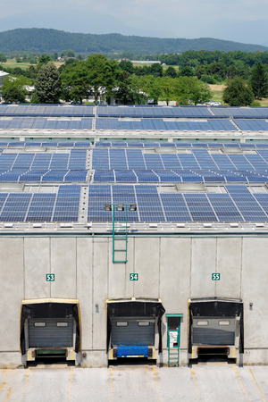 panel: Solar energy electric panels creation on a storage building