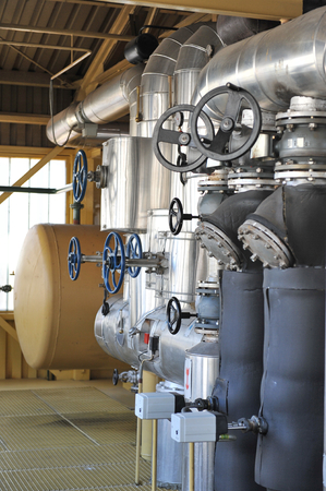 liquids: Pipes, tubes, machinery and steam turbine at a power plant