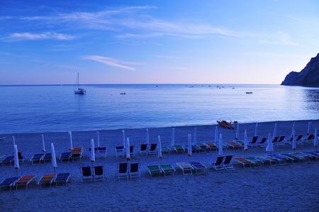 lido: Italian beach, umbrellas and chairs at sunset