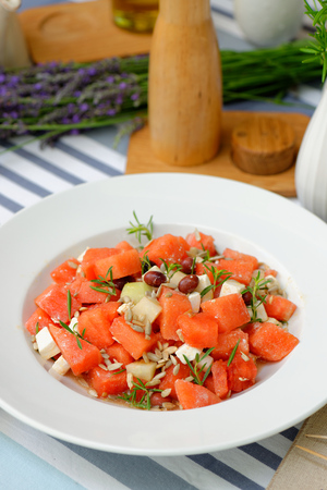 Watermelon Salad with Feta,Cucumber,Olive and rosemary photo