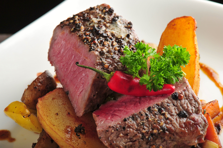 Juicy steak with baked potatoes and mushrooms, Dry aged prime grade beef rib photo