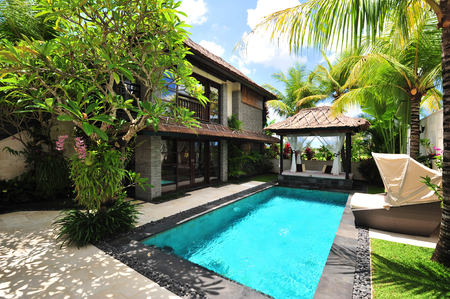 to lap: Modern tropical villa with swimming pool in nature  Editorial