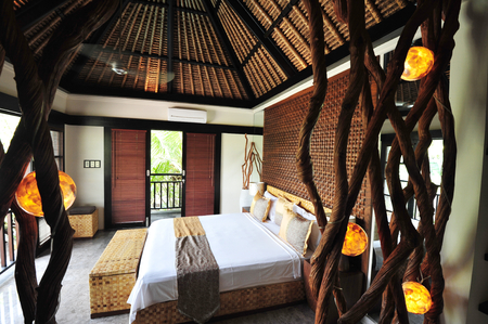 Interior of luxury tropical villa   bedroom Imagens