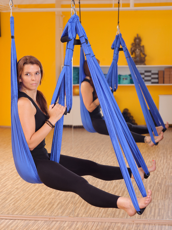 Woman doing anti gravity Aerial yoga exercise  Stock Photo - 28227063