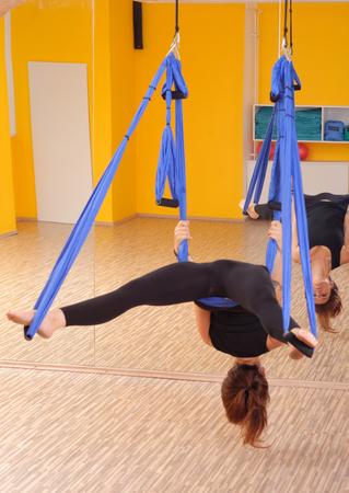 Woman doing anti gravity Aerial yoga exercise Stock Photo - 28227101