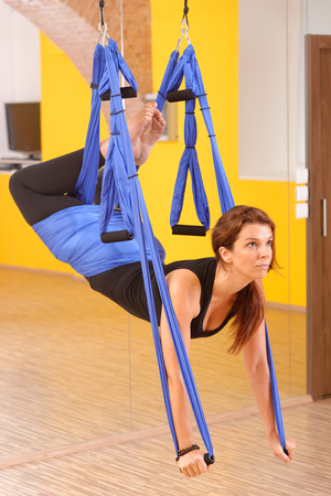 Woman doing anti gravity Aerial yoga exercise  Stock Photo - 28227105