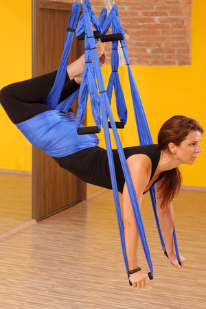 Woman doing anti gravity Aerial yoga exercise Stock Photo - 28227108
