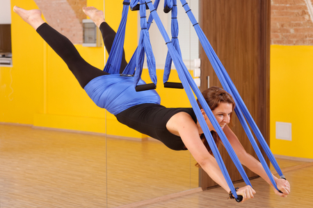 Woman doing anti gravity Aerial yoga exercise  Stock Photo - 28227111
