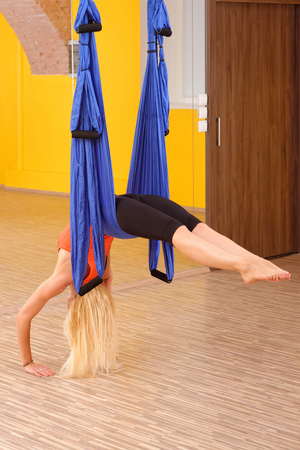 Woman doing anti gravity Aerial yoga exercise  Stock Photo - 28227117