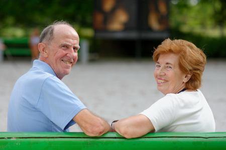 Senior couple sitting on a bench photo