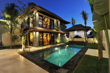 architectural exterior: Modern tropical villa with swimming pool in nature  Stock Photo