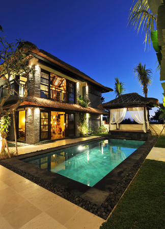 Modern tropical villa with swimming pool in nature  photo