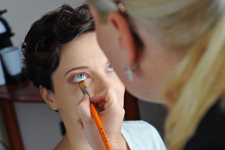 make up artist: Make up artist applying make up to a fashion model   bride