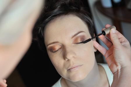 make up artist: Professional make up artist applying make up to a fashion model   bride