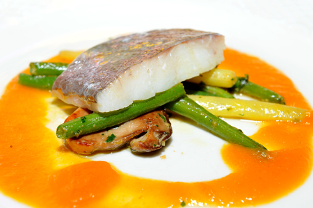 Fine dining, John Dory fish fillet on asparagus Stock Photo