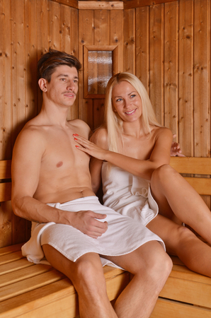 semi nude: Young couple in sauna