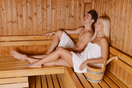 Young couple in sauna  photo