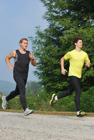 Two young athletes jogging   running in the park  photo