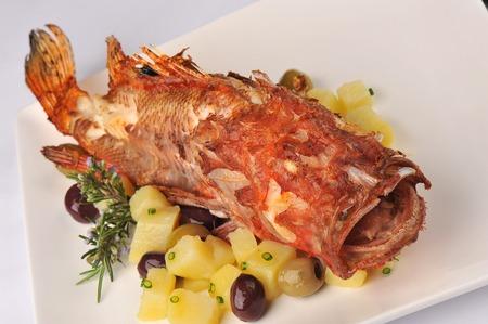 stingfish: Roasted scorpion fish with baked potatoes