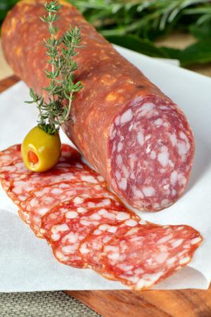 longaniza: Salami sliced on wood background  Stock Photo