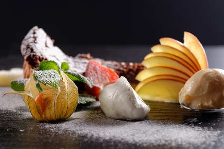 Haute cuisine, dessert on restaurant table, shallow focus depth Stock Photo