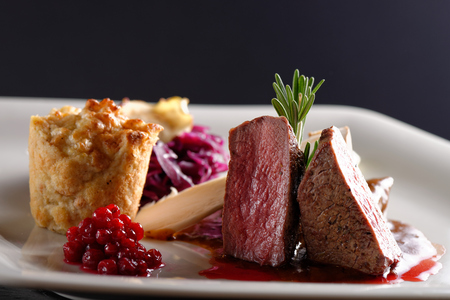 venison: Venison meat steak with red cabbage, cranberries, herbs and Potato
