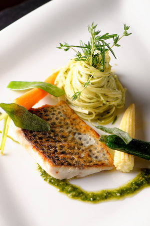 fine fish: Fine dining, Trout fish fillet breaded in herbs and spice with basil pasta