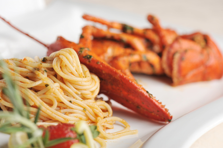 lobster isolated: Seafood pasta linguine with fresh lobster Stock Photo