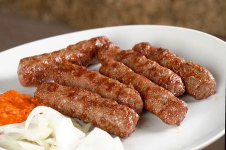 Cevapcici, a small skinless sausage cooked on the barbecue and served