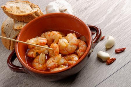 Spanish tapas dish, sizzling prawns with chili and garlic (Gambas Pil Pil).