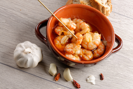 gambas: Spanish tapas dish, sizzling prawns with chili and garlic (Gambas Pil Pil).