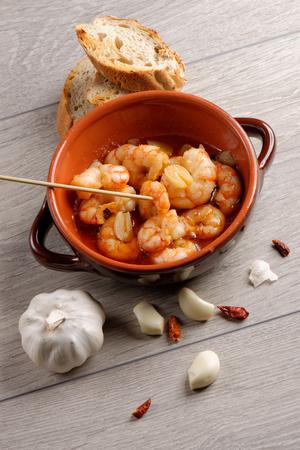 Spanish tapas dish, sizzling prawns with chili and garlic (Gambas Pil Pil). photo