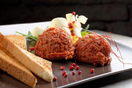 steak tartare: Tasty beef tartare with toast bread and butter Stock Photo