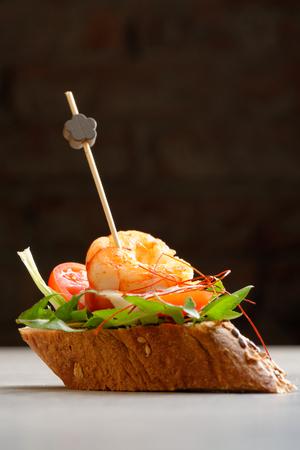 cazuela: Tapas on Crusty Bread Stock Photo